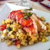 Saffron Butter Poached Lobster over Summer Corn Salad